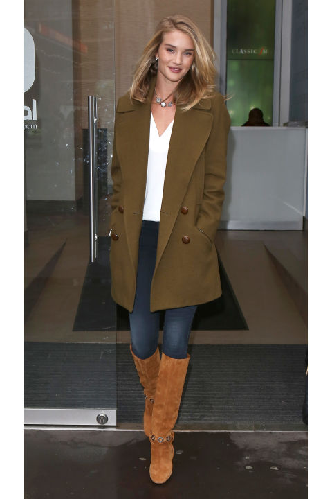 Rosie Huntington-Whiteley looks classic and effortless in a pair of Pucci knee-high boots and military green pea coat.