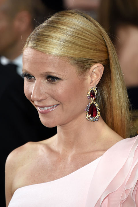 Gwyneth Paltrow opted for ruby red, tear drop earrings that offset her pink gown perfectly.