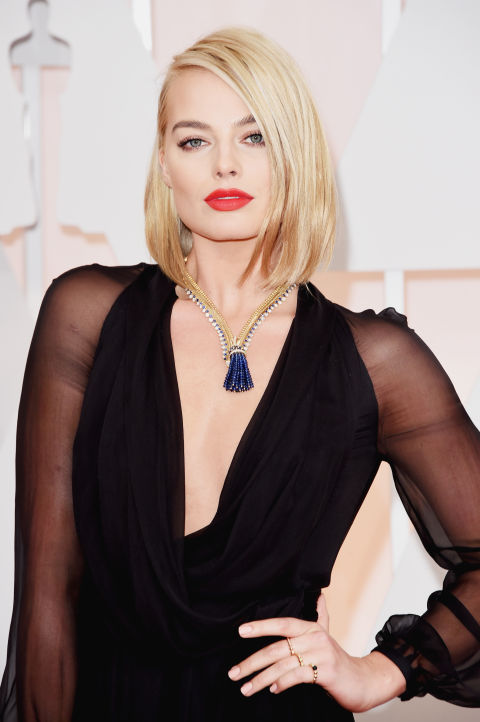 An incredible tasseled vintage Van Cleef & Arpels necklace worked perfectly with Margot Robbie's Saint Laurent dress.
