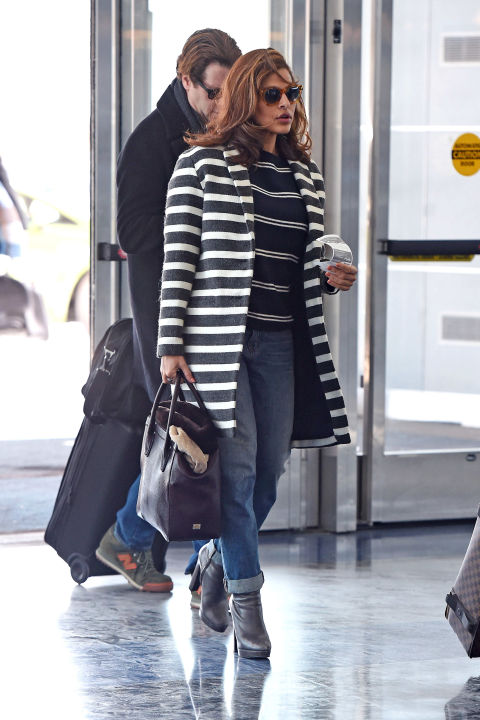 There's no such thing as too many stripes for actress Eva Mendes who paired a patterned shirt and coat with boyfriend jeans to head to the airport.