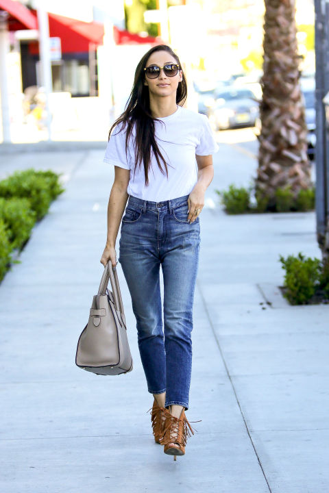 Cara Santana puts her best foot forward in this season's must-have high-waisted denim by 3x1.