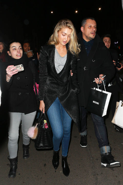 Gigi Hadid takes her A Gold E jeans and t-shirt look into the knight with a shimmering asymmetrical jacket.