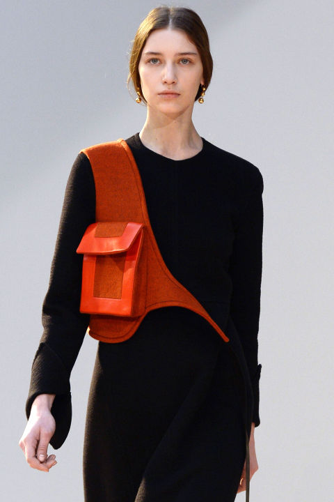 "Phoebe Philo continues to innovate in the accessory arena, this season introducing the holster handbag in an orange shade—the ultimate ""hands-free"" bag."