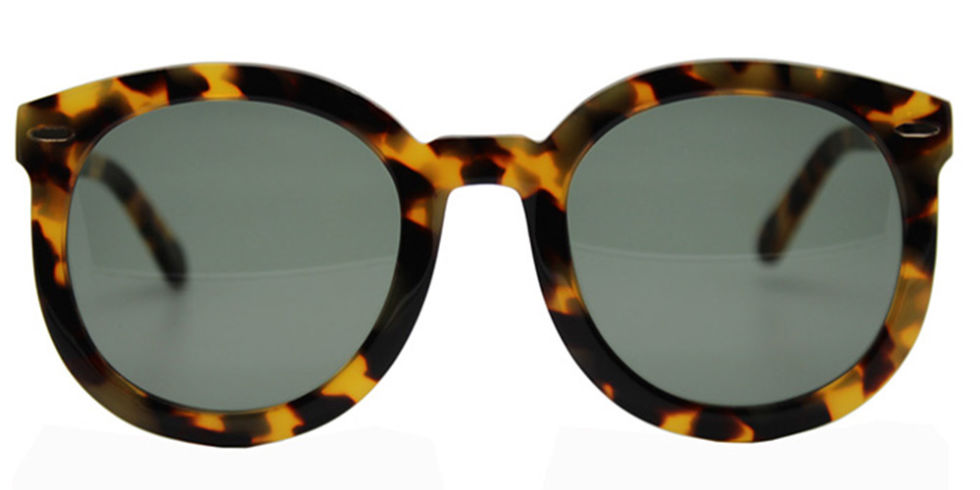 No look is complete without a stylish pair of sunnies—skip the trendy styles for a round pair in tortoise.  Karen Walker sunglasses, $280, barneys.com.