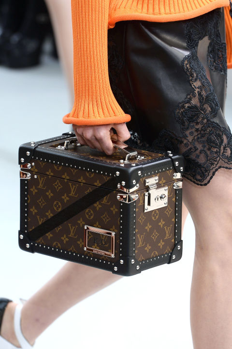 Vuitton is synonymous with its steamer trunks, and after exploring the shape in mini bags in recent seasons, the French house is going bolder with bigger, square trunks—all the better to show off that logo.