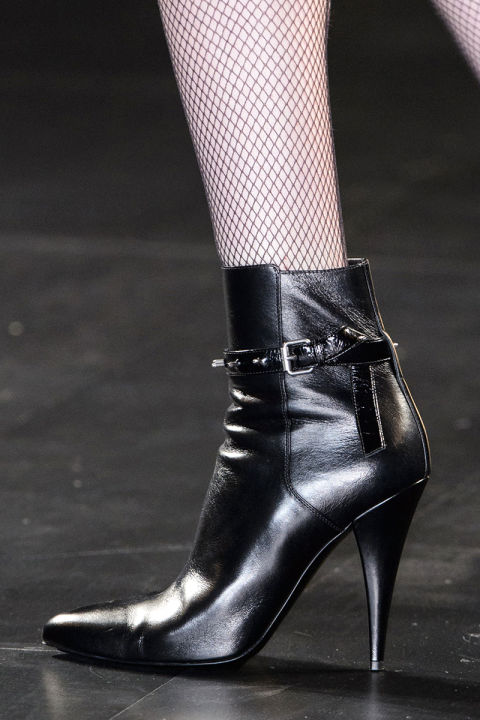 Saint Laurent's rocker chic got the bootie this season—pointy black ankle numbers that will wear perfectly with everything from her black leather mini skirt to skin tight denim.