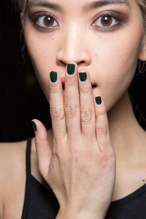 Katie Jane Hughes layered Butter London Nail Lacquer in Racing Green on top of Union Jack Black for a deep, forest green manicure.
