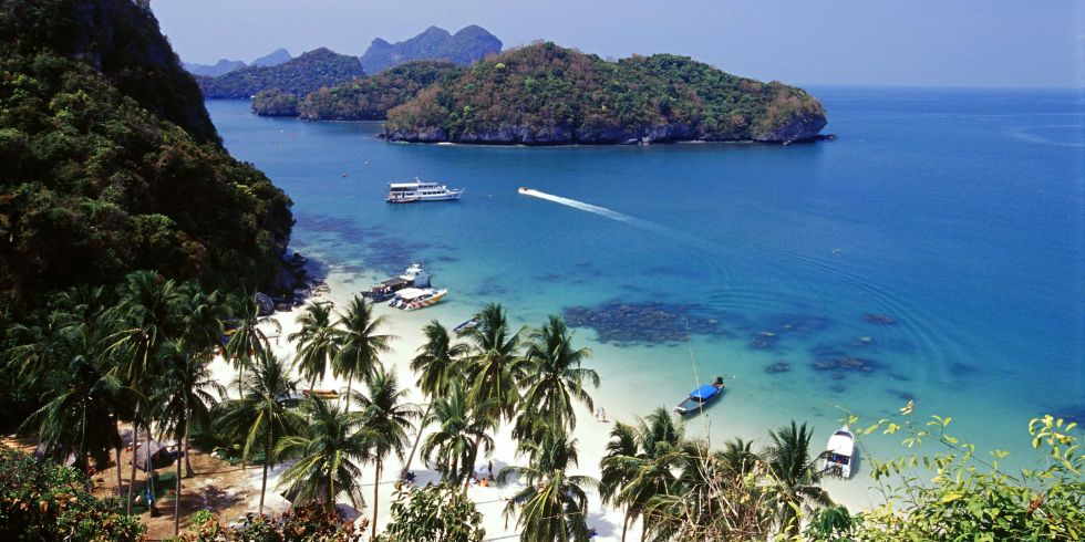 """The """"Land of Smiles"""" sounds like a wonderful place for travelers hitting the road on their own. In addition to having some of the warmest people in the world, and being a very affordable destination, Thailand packs a punch to the senses. From colorful street markets, frenetic urban scenes and sizzling street food to calming, electric-blue water dotted with limestone cliffs and lush jungles surrounding rice paddies, Thailand delivers. As a bonus, the country preaches equality for the sexes, and English is also widely spoken."""