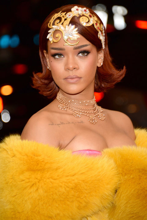Rihanna stole the show with her jeweled headpiece, retro bob and unbelievable yellow gown that required a team to walk it down the red carpet.