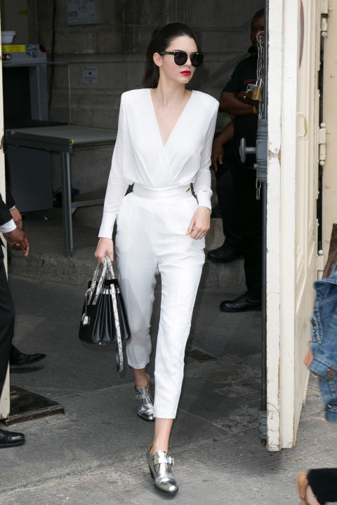 In Paris wearing a white blouse and trousers.
