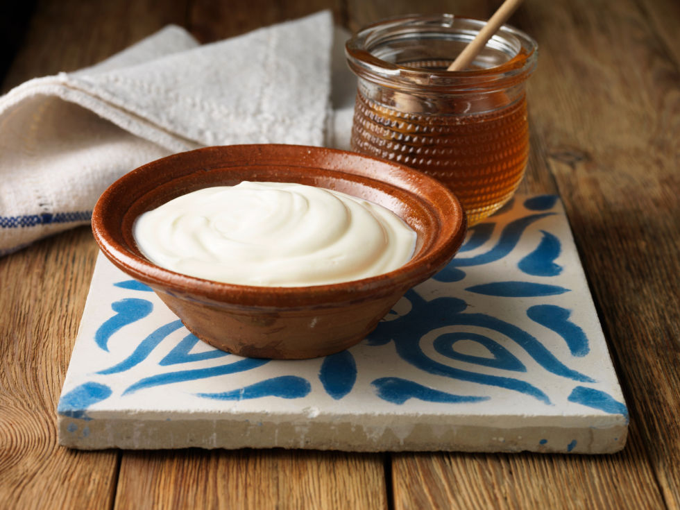 """While this dairy product may not seem like the typical carb, the naturally occurring milk sugars (aka simple carbs) may scare some people away, but they shouldn't — because this creamy snack can help you take off those unwanted extra pounds. Research has found that consuming probiotic yogurt (along with a low-calorie diet) can reduce your body mass index (BMI) and body fat percentage. Lenchewski explains that low-fat Greek yogurt provides a powerful combination of natural sugar and satiating fat, along with packing a major protein punch. """"And the healthy fats and protein can prevent blood sugar levels from dropping, which will help keep sugar cravings at bay.""""<br />"""
