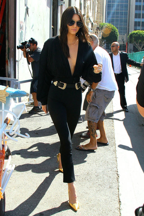 In Los Angeles wearing a Bri Bri B-Low the belt, high-waisted black skinnies and a Esosa top.