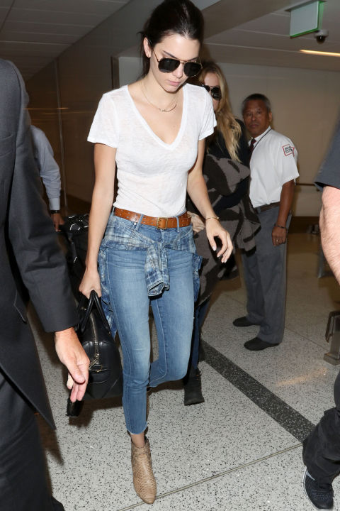 Laving LAX wearing a white t-shirt, cropped jeans and ankle booties