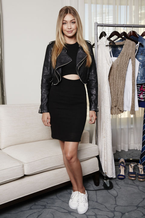 In a Guess dress and leather jacket