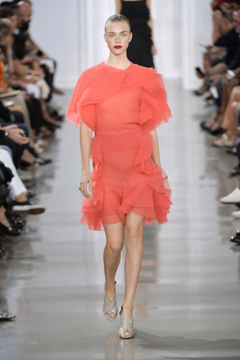 Wu's dresses let loose the flou, with ruffles and frills piled on top of vibrant pink. But you could still imagine this hanging in the same closet as a sexy sheer black lace cami and tulle skirt that preceded. There's always two sides to a story, right?