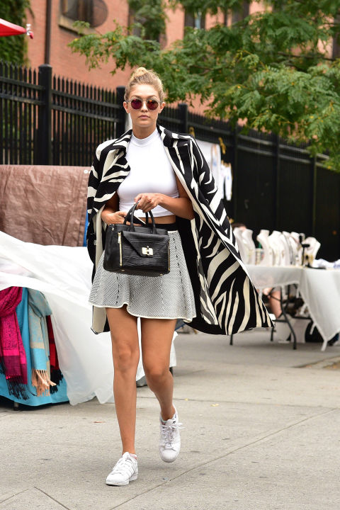 While running between shows at New York Fashion Week, Hadid masters the perfect model off-duty look in an affordable Lucy Paris skater skirt available for $65 and a Donna Mizani Cropped Mock Top available for $92 at Revolve Clothing.