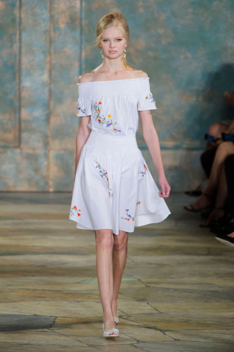 "Burch was inspired by ""beauty found in unexpected places."" The beauty at Lincoln Center, enhanced by the placement of giant Moroccan Doors, may not be unexpected but there it was. A smocked floral skirt and top are also doubtlessly pretty."