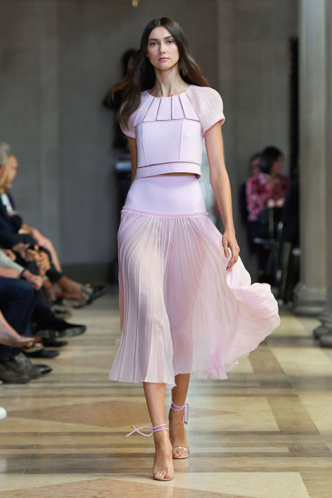 But happiness and design chops are not mutually exclusive. Herrera showed cut-out looks throughout the lineup—tops, skirts and dresses whose sheer thin lines offered keen visual interest and grounded the cotton candy prettiness.