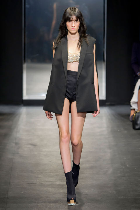 Wang mixed sporty bras and briefs with tuxedo vests and men's blazers. And every once in a while, she threw in a tailored skirt or button-down blouse with extra volume in sheer gauze. There were hints of shine, too, in spangled tube tops.