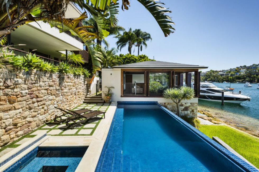 spend your days lounging on sun beds at this waterfront sydney retreat which sleeps eight the spacious home is made of natural tones of timber airbnb sydney