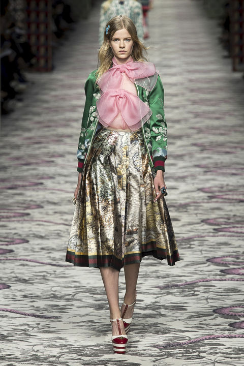 "It seems a post-minimalist world is one with pussy-neck bows, embroidery, embellishment, lamé, layers and retro shapes with sharply modern updates. The word on these mash-up runways is ""more is more."" Pictured: Gucci"
