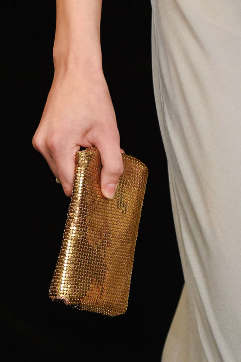 High fashion is embracing tech—your post-modern clutches are now equipped for your iPhone 6. Pictured: Saint Laurent