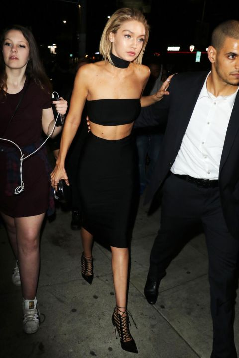 The model heads to Justin Bieber's AMAs after party at The Nice Guy Restaurant in Los Angeles in a choker, strapless bra top and pencil skirt.