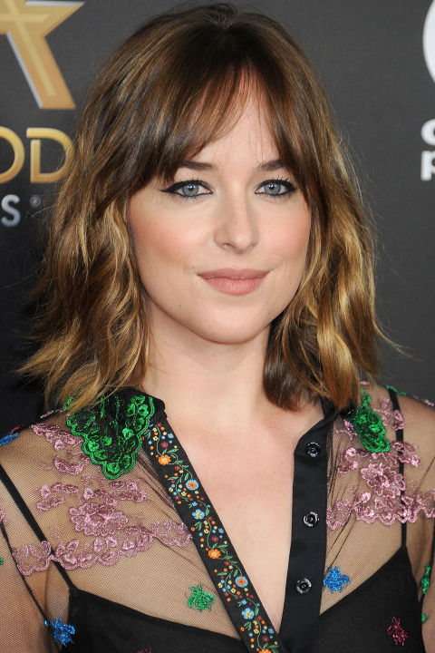 Gradually taper bangs you're trying to grow out so that they blend seamlessly into razored layers that hit at the chin and stop just above the shoulders—you'll never hit the awkward stage.