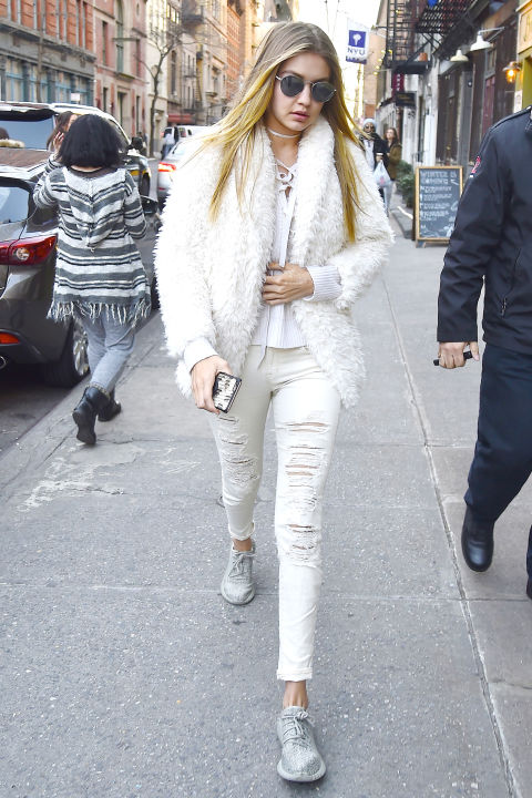 Hadid put her own spin on winter whites with distressed denim, a fur jacket and matching choker.