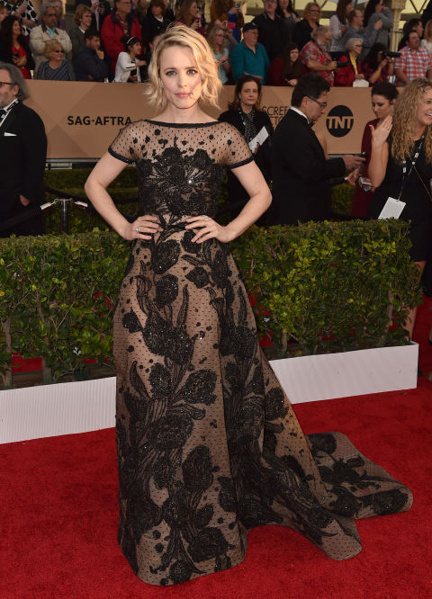In an Elie Saab dress, Brian Atwood shoes and Lorraine Schwartz jewelry.