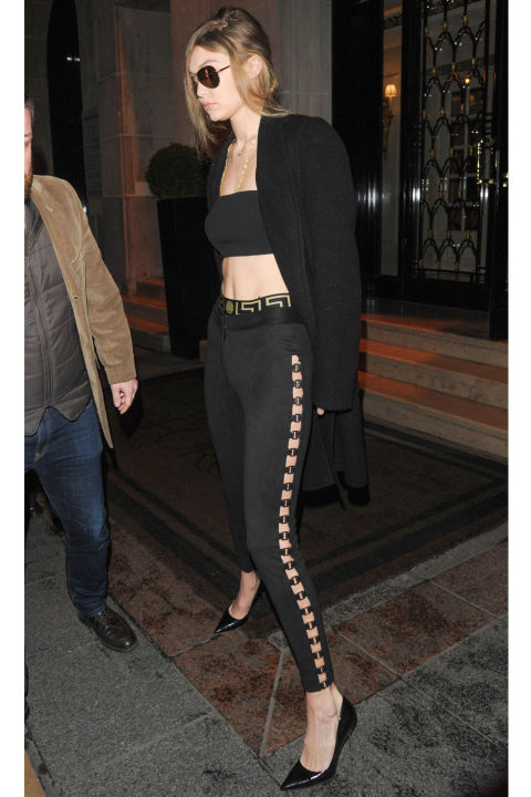 The model steps out in The City of Light wearing a crepe crop top and suede pants by Vatanika, paired with Kurt Geiger pumps.