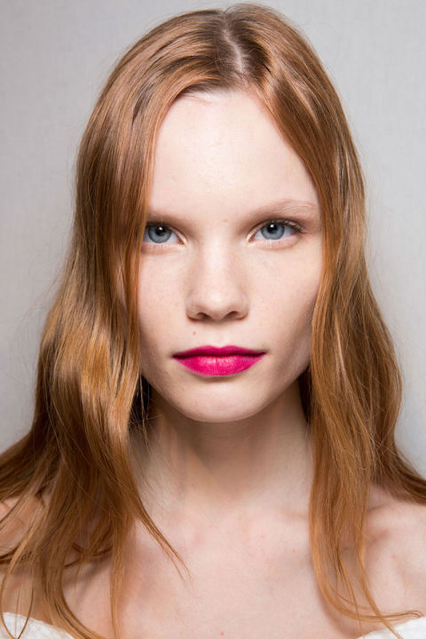 Like the Fall collection, the hair and makeup were a loud celebration of color, texture and quirkiness. Pat McGrath gave models one of three looks: au naturale, exaggeratedly pink cheeks or fuchsia lips (the shade—Gucci Sensuous Deep Matte in Adrenaline—launches June 2016), while Paul Hanlon played with the hair's texture, adding a bit of wave and shine to girls with straighter hair, embracing and enhancing curly hair and throwing some crimped strands in on others just for fun.<br />