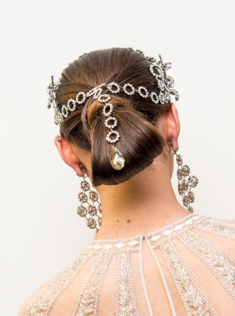 Necklaces became headpieces at Naeem Khan–using the fastening on a statement piece as a lariat for a long looped updo. Do the same with standout earrings, brooches or pendants.