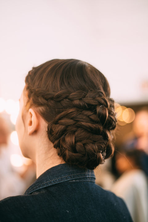 Another take on the romantic chignon? Take a note from Lela Rose Bridal Spring 2017. Loads of braids added drama at the back, but kept all the attention focused on the face from the front. This is the bridal equivalent of business in the front, party in the back...