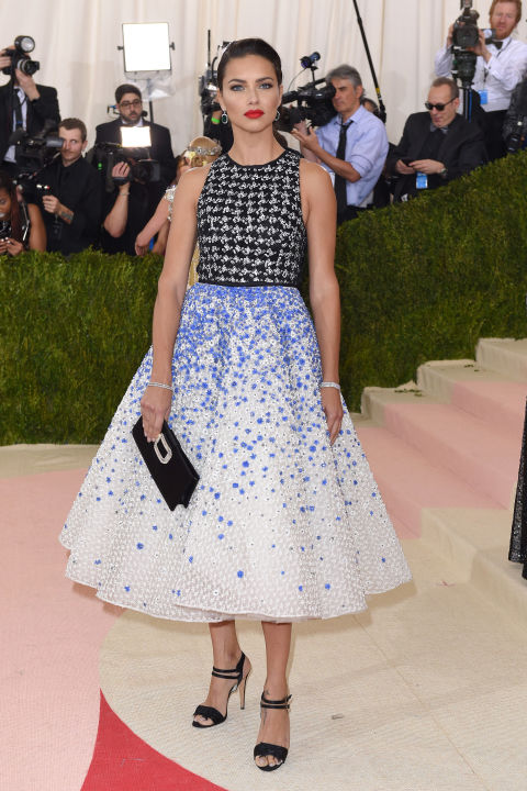 in Giambattista Valli Haute Couture dress, Chopard jewelry and Roger Vivier bag