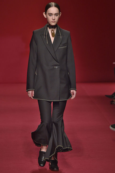 Ellery is the great Aussie international success story. Designer Kym Ellery now shows in Paris, and editors clamor over her curvaceous, monochromatic tailoring. A proud Aussie with a European flair, Kym is also the best advertisement for her clothes. Flared sleeves, flared trousers, flair all over.