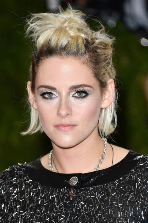 Metallic eye makeup paired with short, twisted tresses is the kind of pretty punk look we didn't know we loved. <br />