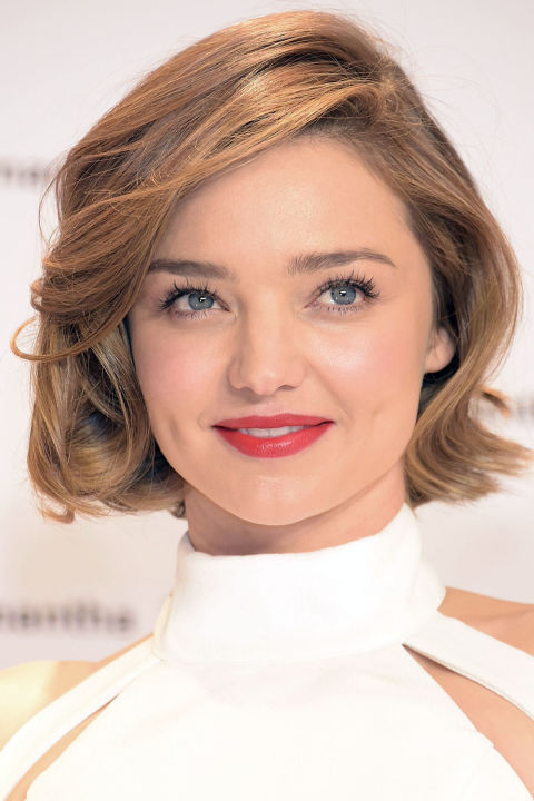 Miranda Kerr appears effortlessly polished while mastering fall's biggest trends: a jaw-dropping bob and a high neckline<br />