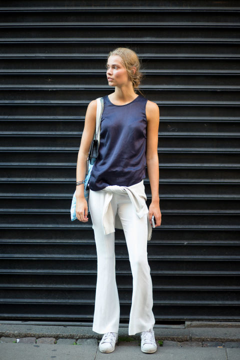 Keep things simple with a pair of white flared jeans and basic tank top.