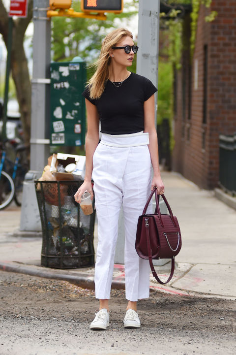 Take note from Karlie Kloss and opt for a pair of high-waisted cropped pants that fall just above your ankle with a pair of simple lace-ups.