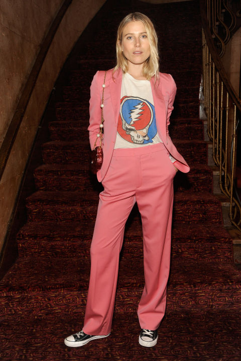 Dree Hemingway balances a feminine pink suit with a hippie tee.