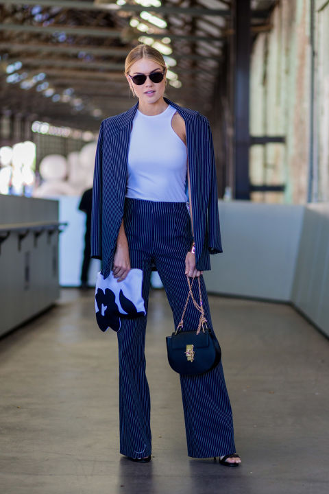 Elyse Knowles' navy pantsuit could read workwear save for a fitted white tank to up the cool girl appeal.