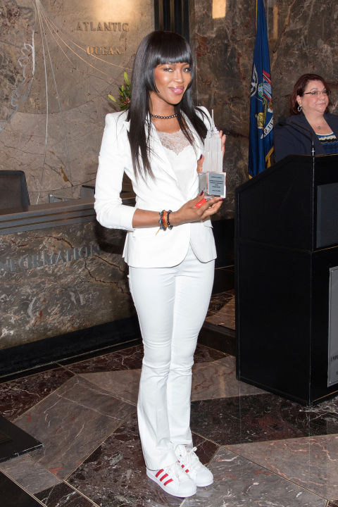 The always-elegant Naomi Campbell shows her sportif side, pairing a white suit with adidas originals.