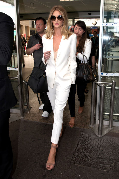 Rosie Huntington-Whiteley's slim white suit by Magda Butrym, paired with neutral sandals, is a star.