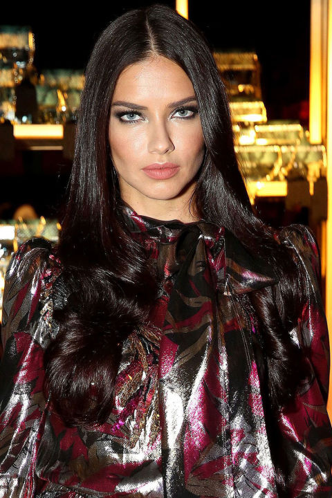 Who: Adriana Lima What: Sexy Summer Eyes How: For the launch of Marc Jacobs' new fragrance, Divine Decadence, makeup artist Morgane Martini rimmed Lima's eyes with tons of sooty black liner, added plenty of false lashes, then finished with just the glintiest touch of luminescence along the inner corners. The overall effect? Sexy, sultry, and very, very Lima. Editor's Pick: Clinique High Impact Custom Black Kajal, $17, sephora.com.