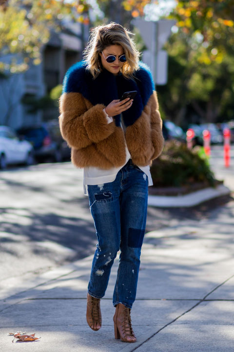 Create a high glam/low effort mix by throwing on a plush fur coat over a basic tee and jeans.
