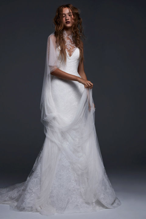 Light ivory V-neck silk mermaid gown with illusion high neck accented by hand placed Chantilly lace applique.