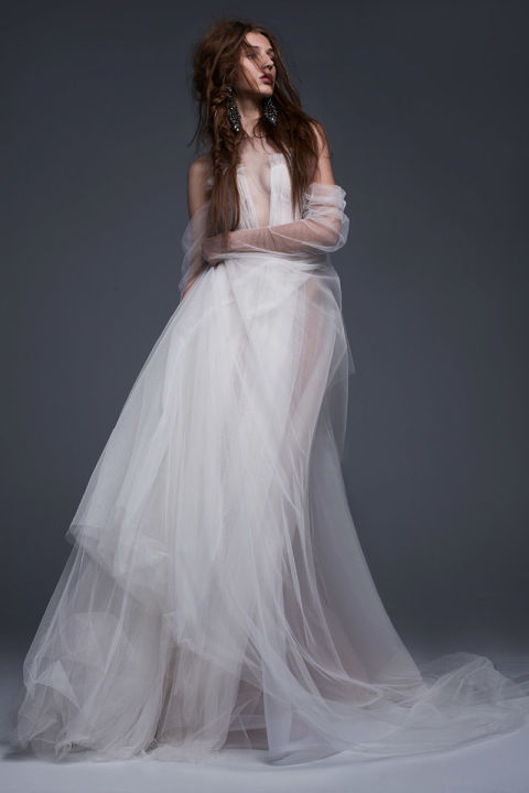 Light ivory hand draped French tulle A-line off the shoulder gown with draped sleeve accents.