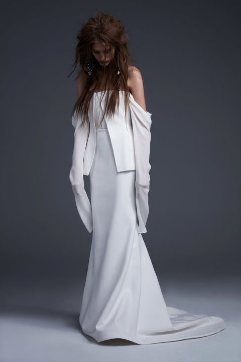 Soft white silk crepe off the shoulder tailored gown with corset detailing and silk georgette draped sleeves.
