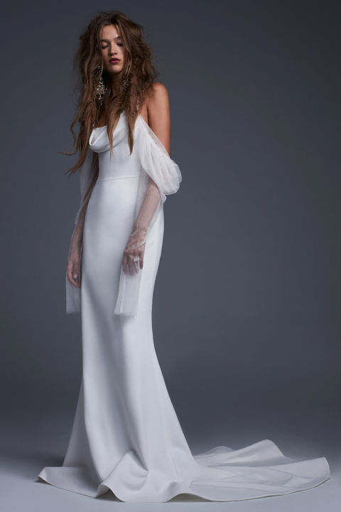 Soft white silk crepe off the shoulder cowl neck gown with French tulle draped sleeves.